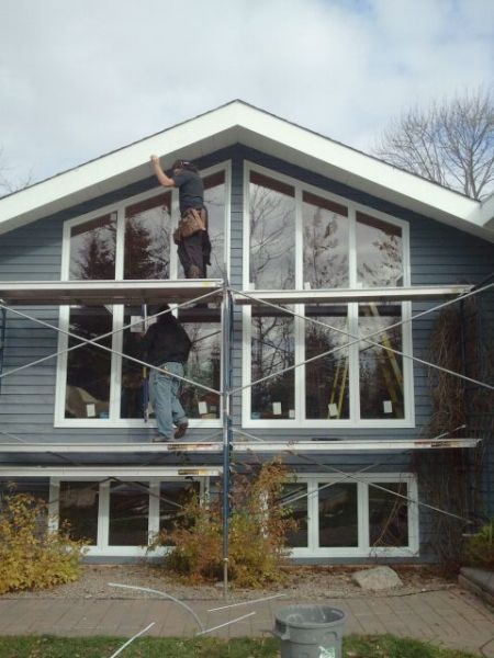 Bay windows being installed matheson